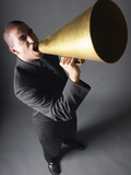 Angry Businessman Yelling Into Bullhorn