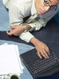 Businessman Working on Laptop on His Desk