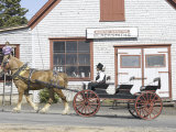 Horse-Drawn Wagon Driving Past Blacksmith Shop