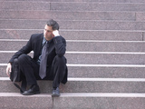 Dejected Business Sitting on Steps
