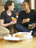 Couple Eating Pizza and Drinking Beer on Moving Day