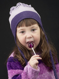 Little Girl in Toque with Lollipop
