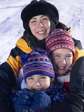 Family Posing on Snow-Covered Hill