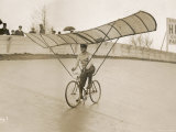 Grinning Cyclist Tries to Get His Glider Airborne at the Parc des Princes Stadium Paris