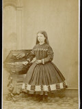 Girl Wears a Dress with Loose Pleated Bodice a Crinoline Supported Short Skirt