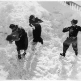 Three Young People Enjoying a Snow Fight