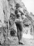 Girl in Bikini Walks Along a Cliff Path on a Fine Summer Day