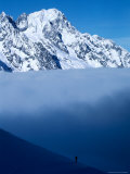 Lone Skier Looking Up at Cloud Bank  Italy