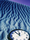Clock Reading 11:55 Pm in the Sand