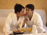 Vacationing Couple Enjoy Room Service Breakfast