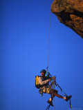 Rock Climber Hanging off Cliff