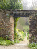 View Through a Gateway and into the Garden Beyond  Hadspen Gardens Somerset