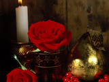 Lit White Candle in Gold Holder with Two Red Roses  Ilex Berries & Gold Pear Christmas Ornament
