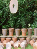 Empty Terracotta Pots Lined Up  Suspended Clay Disc Ornament  Chelsea Flower Show 1997