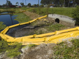 Floating Yellow Barriers in Borrow Pit Pond Control Runoff of Construction Site  Sarasota  Florida