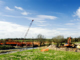 Crane Lifitng Steel Piling Beside River Avon During Construction of the Barford Bypass  England