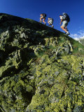 Hikers Climbing Rocks
