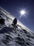 Man with Dog Climbing Arapahoe Peak in Strong Wind and Snow  Colorado