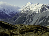 Hikers Look up at Snowy Mountain Top  New Zealand