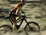 Close up of Fast Moving Mountain Biker  Mt Bike