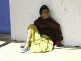 Old Woman Sitting Against a Wall  Nepal