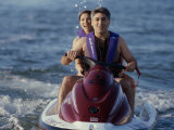A Couple Riding a Jet Ski in the Sea