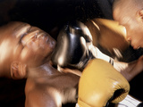 Side Profile of Two Male Boxers Fighting