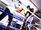 Trainer and Boxer in the Ring