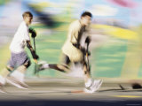 Motion Blurred Image of Teens Playing Street Hockey