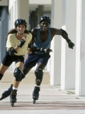 Man and Woman in Rollerblades
