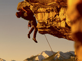 Mountain Climber Hanging from a Rock