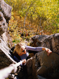 High Angle View of Young Woman Rock Climbing