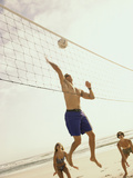 Low Angle View of Three People Playing Volleyball on The Beach
