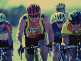 Group of Cyclist Cycling in a Race