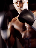Close-up of a Male Boxer Wearing Boxing Gloves