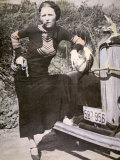 Bonnie Parker Posing Tough with a Gun and Cigar  c1934