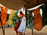 A Sudanese Woman Buys a Dress for Her Daughter at the Zamzam Refugee Camp
