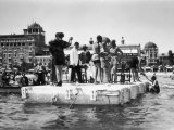 Several Young Men and Women on a Platform in the Water  Some of Them Dancing  on the Lido of Venice