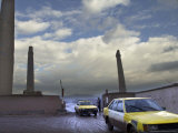 Taxis Pass a Guard in Herat  Afghanistan  in This December 7  2001 Photo