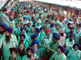 Indian Sikh Pilgrims Wait for Immigration Clearance at Wagah Railway Station Near Lahore