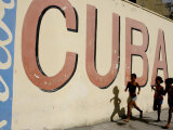 Cuban Girls Run in a Street in Havana  Cuba  Thursday  August 10  2006