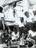 On the Deck of a Ship  a Boy Acts as a Shoeshine Around Him  Other Boys in Sailor Clothes