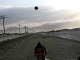 Afghan Boys Play with a Ball in Kabul  Afghanistan  Friday  July 7  2006