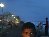 A Sri Lankan Boy Looks as He Sells Prawns at the Sea Front  in Colombo  Sri Lanka  June 30  2006