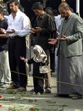Iraqis  Inluding a Little Girl  Pause to Pray
