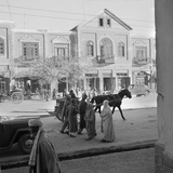 Men and Women  Wearing the Traditional Burqa  Walk Along a Street in Kabul
