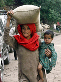 A Woman Carries Relief Supplies at Jula Village  Near Uri  India