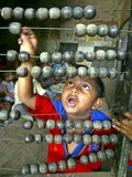Boy  3  Counts on an Abacus at a School in Allahabad