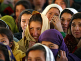 Afghan Children Watch a Performance by Their Fellows During a World Children's Day Get-Together