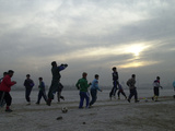 Afghan Youths Warm up Themselves Before a Soccer Match